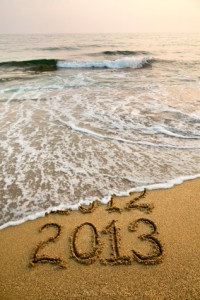 2013 and 2012 written in sand with waves
